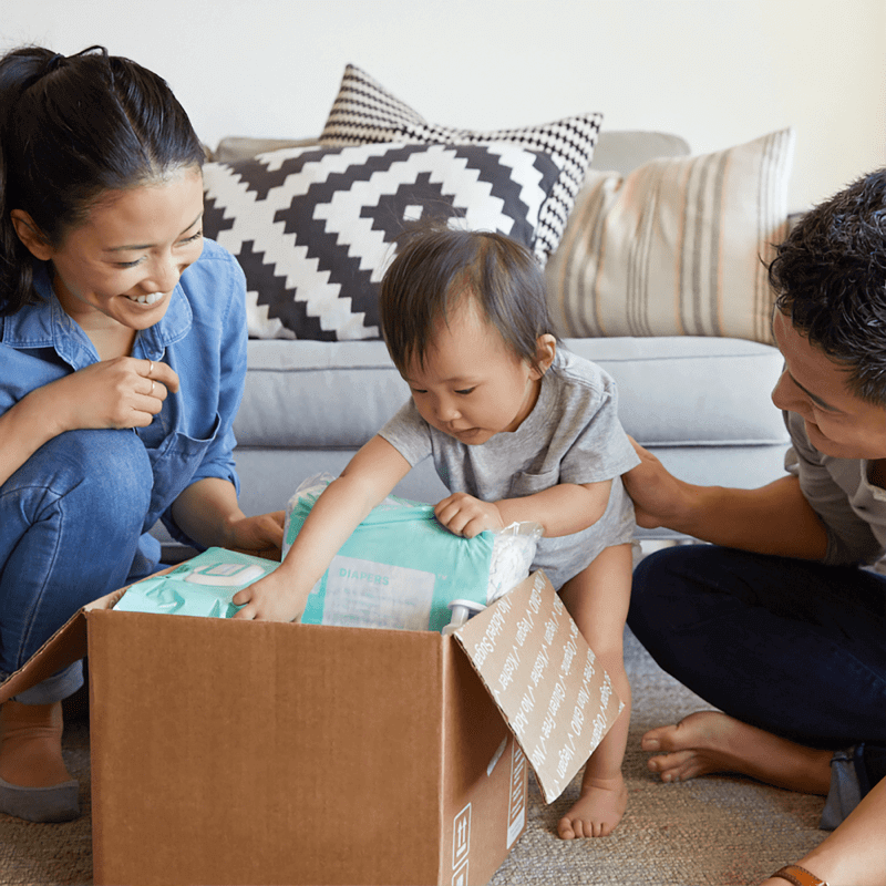 Mortgage Rates Canada - Family unpacking boxes