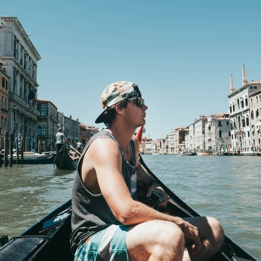 Man on canal boat in Venice square